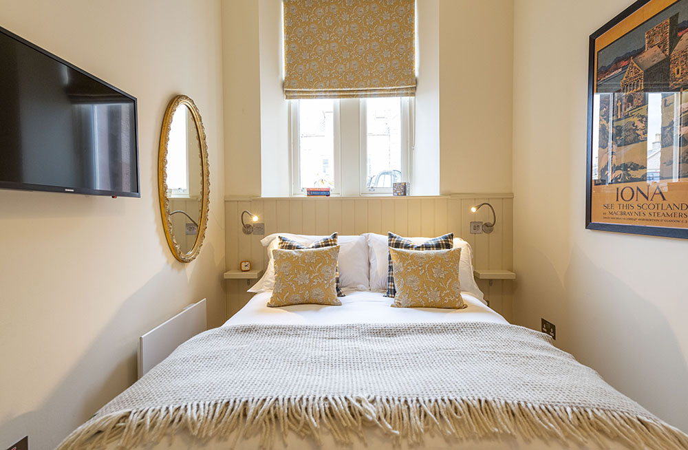 The bedroom in our Croft House Apartment, featuring smart TV
