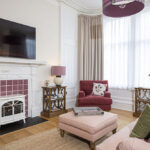 The cosy living room in our Scottish Thistle Serviced Apartment, Inverness