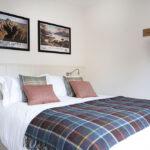 King sized bedroom, Tree House within Art House Apartments Inverness