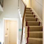 The stairway in our Tree House serviced apartment Inverness
