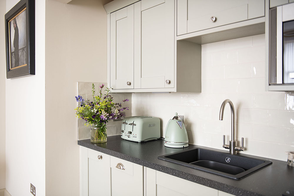 The kitchen area in our Running Hare Serviced Apartment Inverness